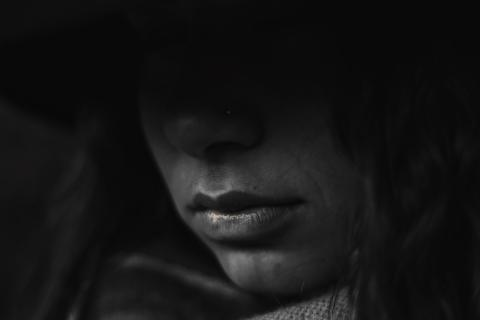 Picture of girl's face in darkness